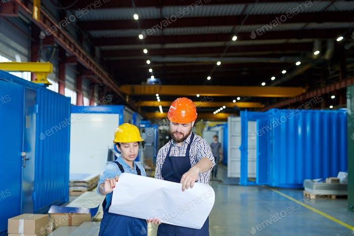 Engineers Studying Blueprints