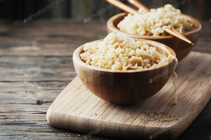 Asian fast food noodle on the wooden table