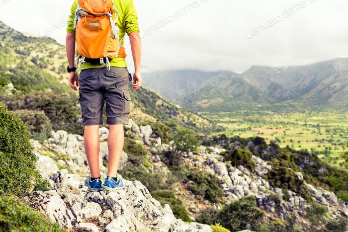 Hiking man looking at beautiful mountains