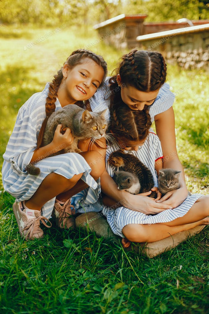 three beautiful girls with cats