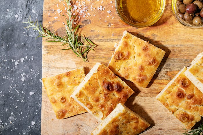 Baked focaccia bread served with olives
