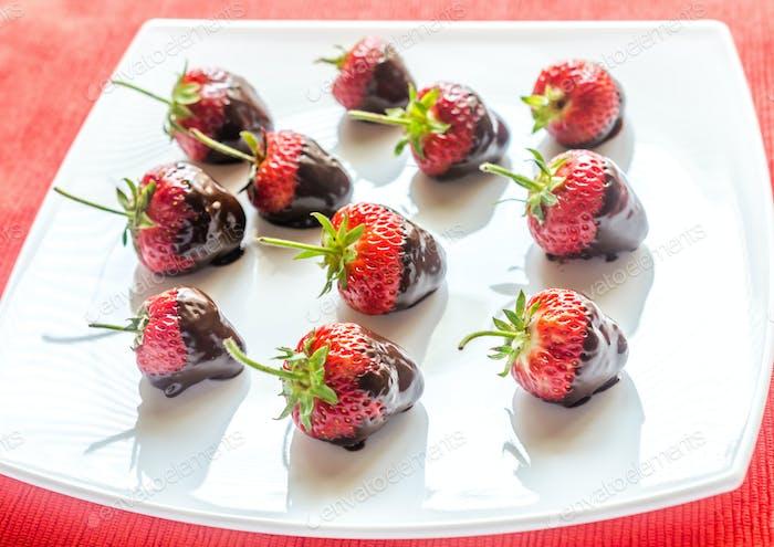 Fresh strawberries covered with dark chocolate