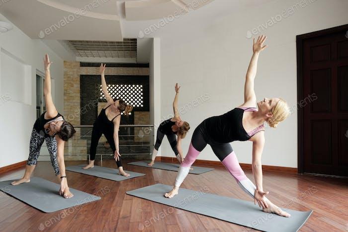 Flexible women Doing Triangle Pose