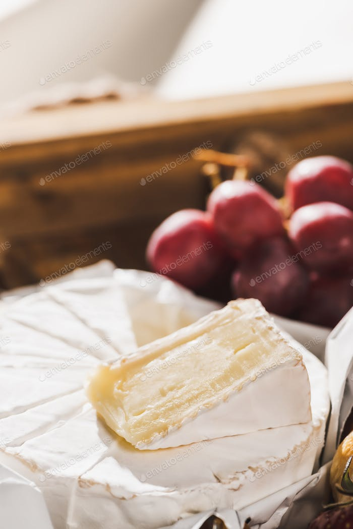 Close up View of French Breakfast With Camembert And Grape on Wooden Tray