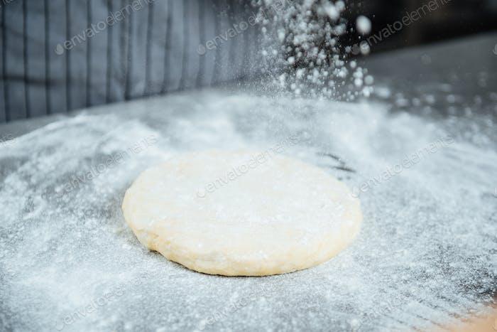 Fresh dough in white floor on the table