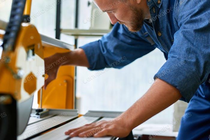Factory Worker Using Machines