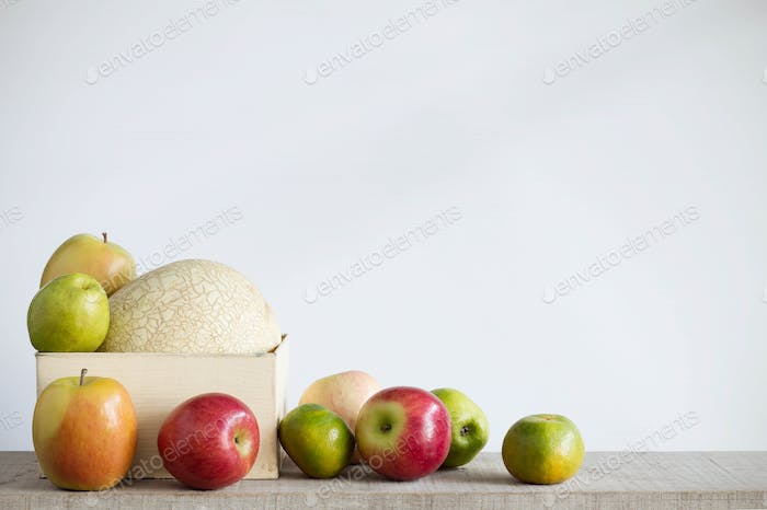 Apples and melon with a white background