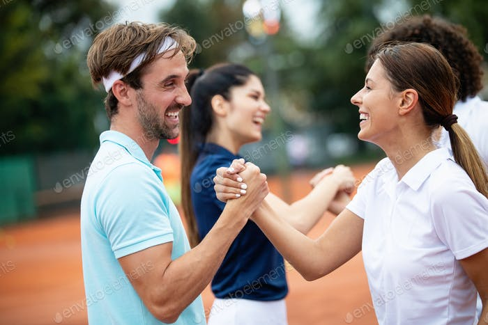 Group of tennis player handshaking after playing a tennis match. Fairplay, sport concept