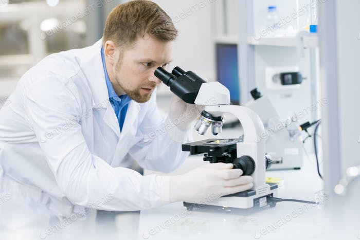 Modern Scientist Doing Research in Laboratory