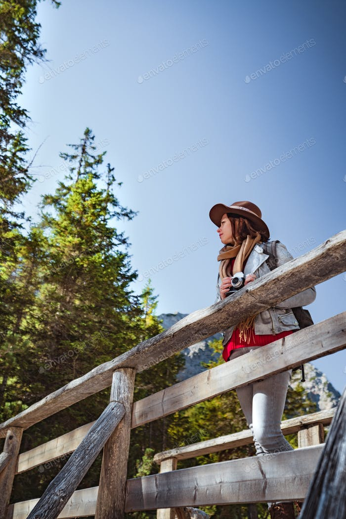 Attractive woman on a wooden bridge