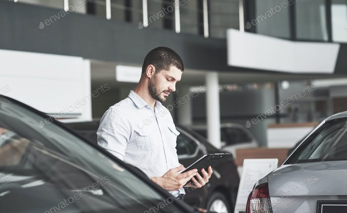 Young sellers with a folder for selling a new car