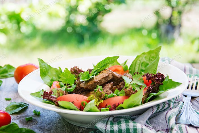Meat salad with liver and fresh vegetables.