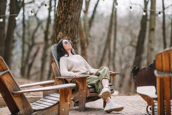 Woman relaxing in the forest on weekeend