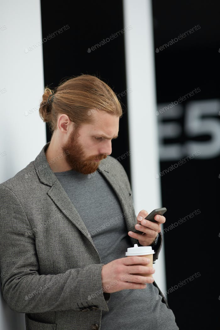 Concentrated man reading sms