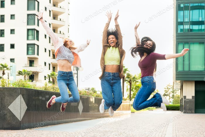 Three exuberant young woman leaping into the air together