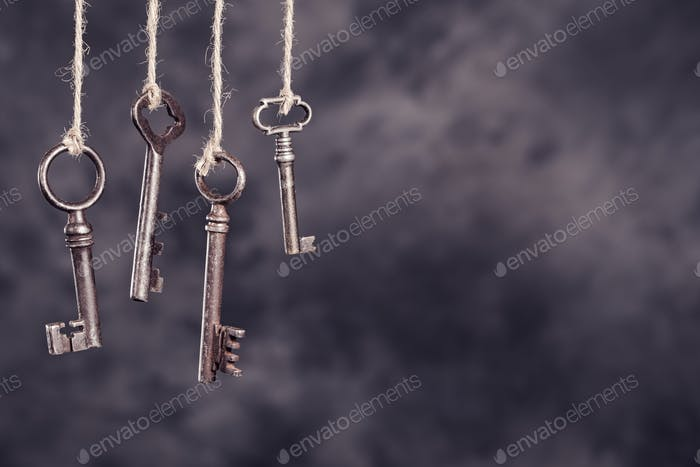 Four old keys hanging