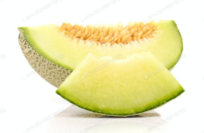 Melon cut piece isolated on white background.