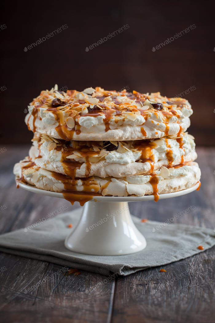 Homemade and delicious meringue cake with caramel