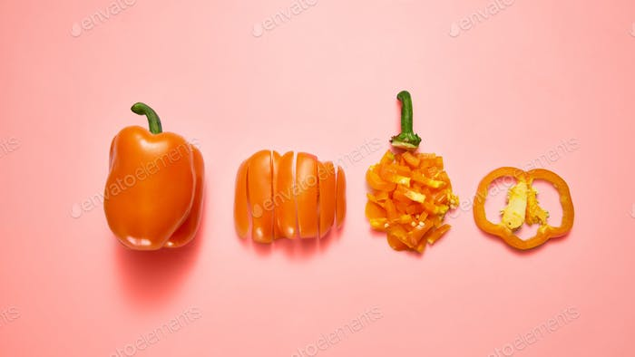 Juicy fresh natural pepper sliced and whole on a color background of the year 2019 Living Coral