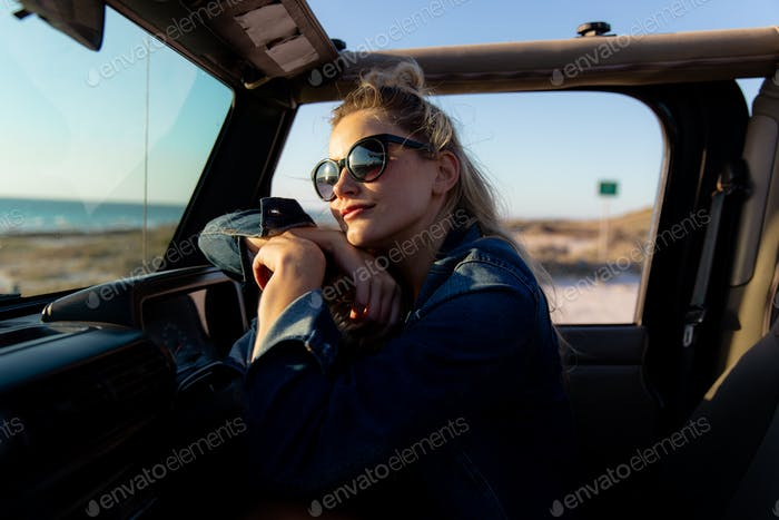 Woman relaxing in a car