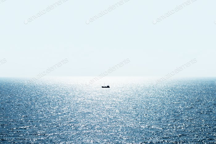 Lonely fishing ship trawler boat on ocean