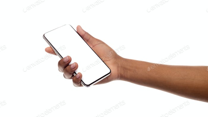 Black woman's hand holding mobile phone with blank screen