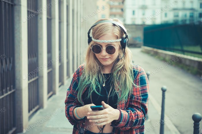 beautiful young blonde hair woman hipster listening music