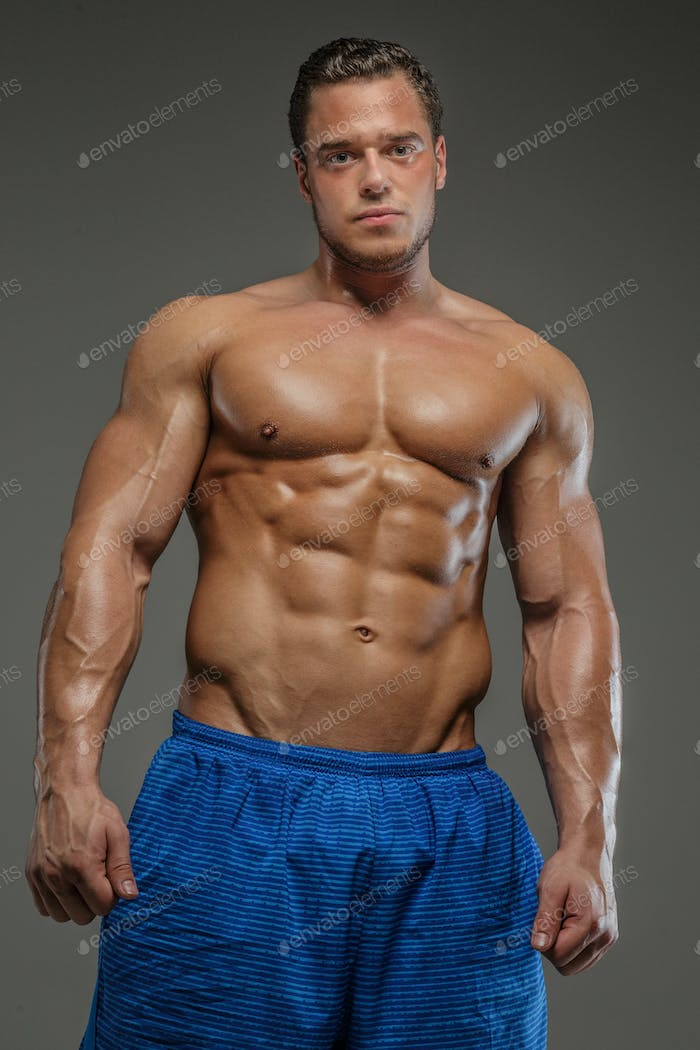 Muscular guy in blue shirts showing his muscles