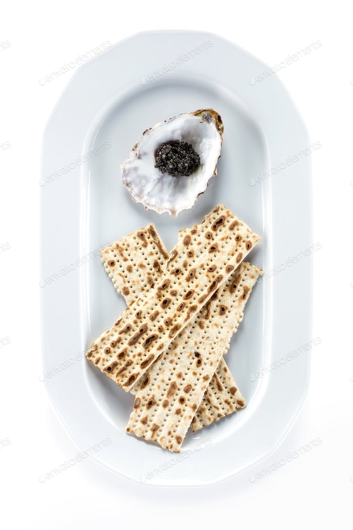 Black sturgeon caviar and matzah on plate