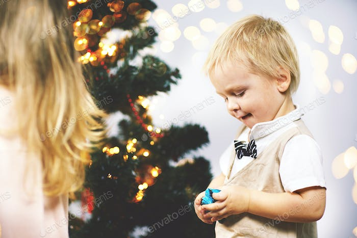 On Christmas night a little boy in a suit with a butterfly