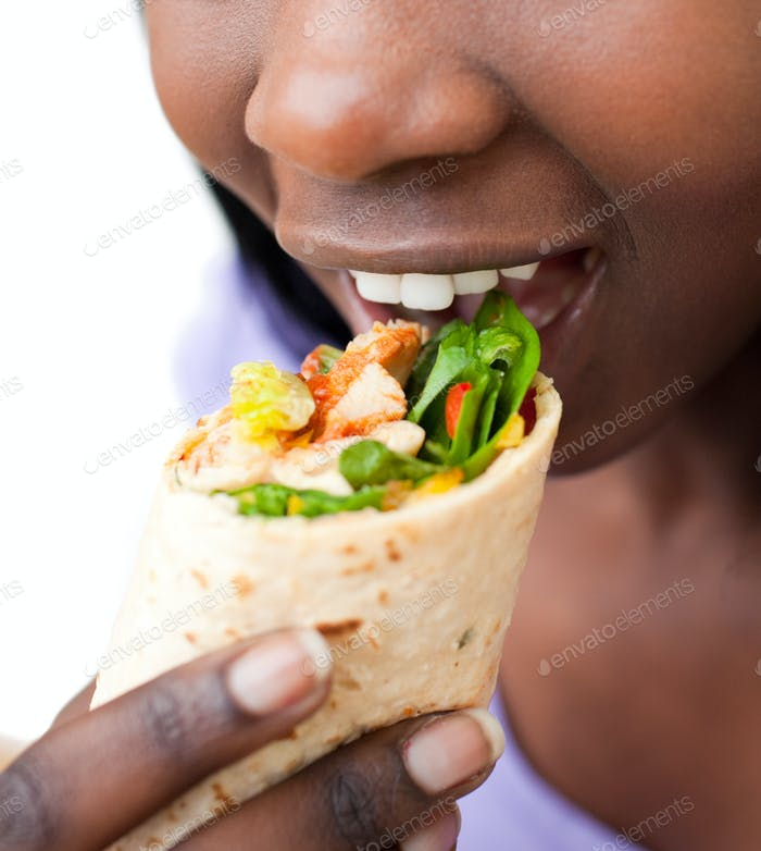 Close-up of a woman eating a wrap
