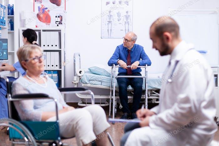Senior man sitting on hospital bed