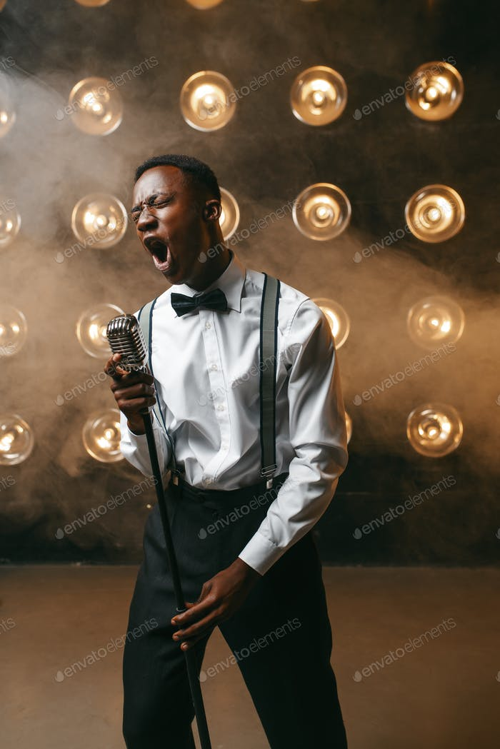 African jazz performer singing on the stage