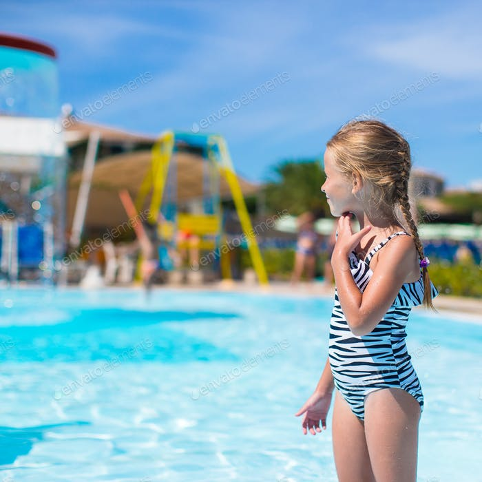 Little girl at aquapark during summer holiday