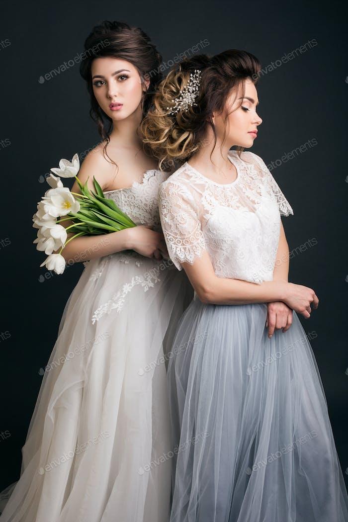 two young beautiful stylish women, bride, bridal fashion