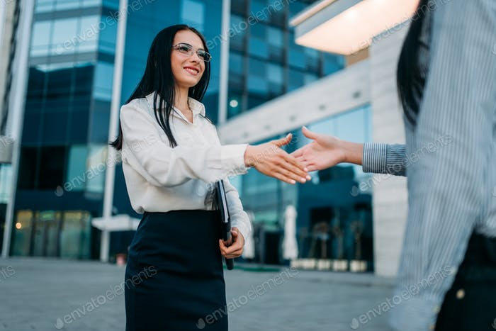 Business woman, handshake with partner outdoor