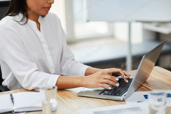 Businesswoman Typing on Keyboard