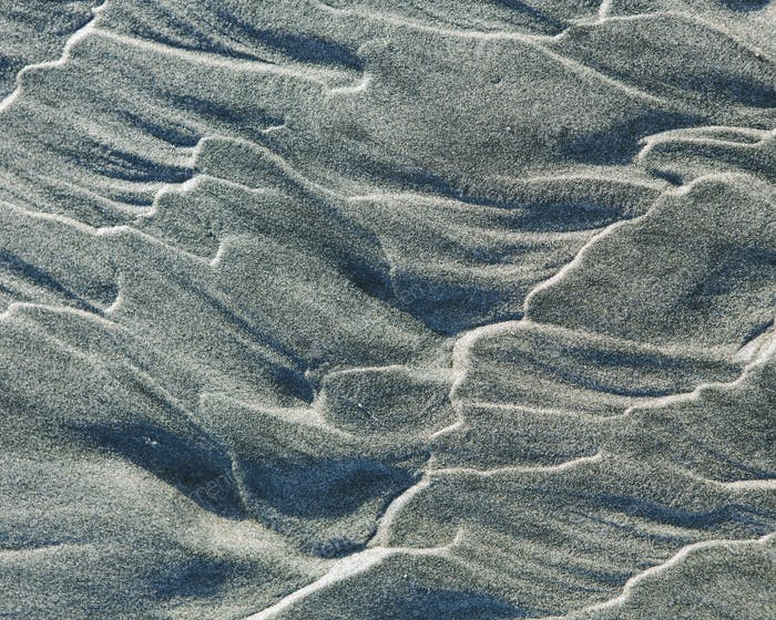 Close up of erosional sand patterns on beach