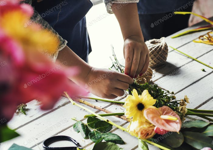 Florist making a flower arrangement in a flower shop