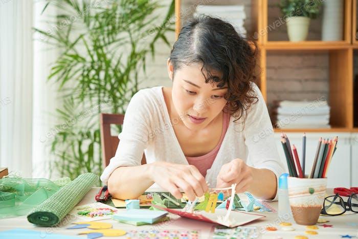 Japanese Woman Focused on Scrapbooking