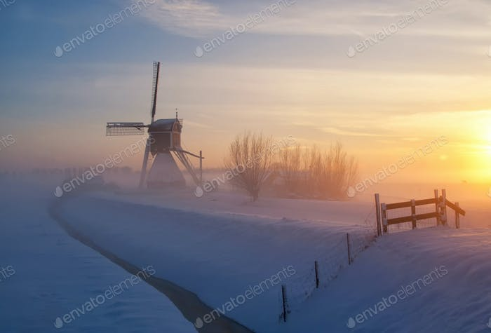 Wingerdse mill near Oud-Alblas in the Dutch region Alblasserwaard in a misty and wintry landscape