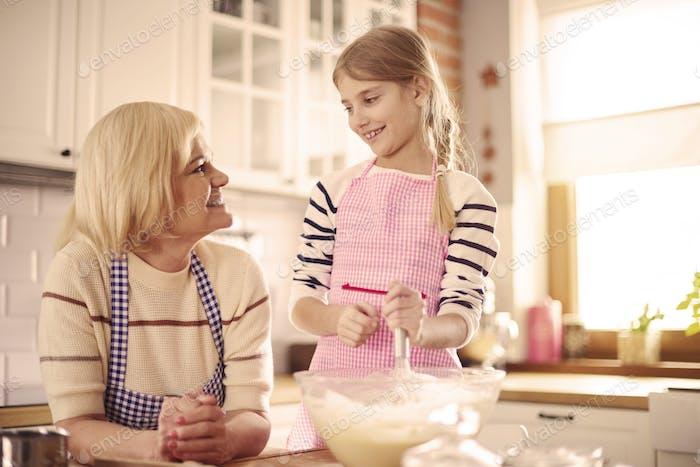 Grandparent and grandchild baking together