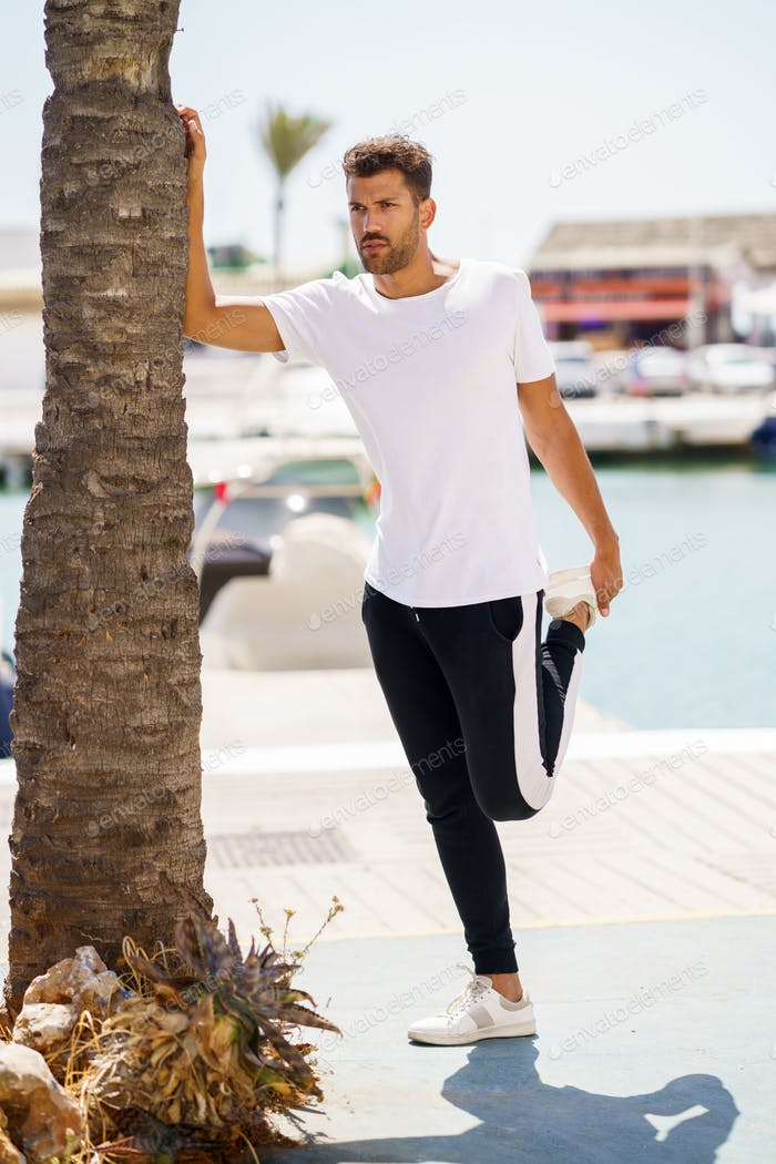 Placeit – Man stretching after exercise in a harbour