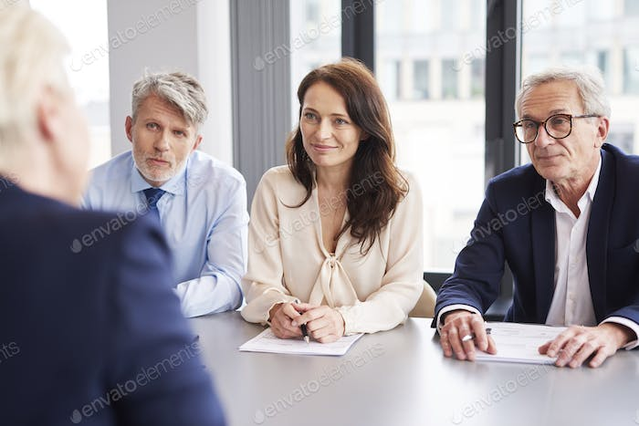 Serious, business talks at conference table
