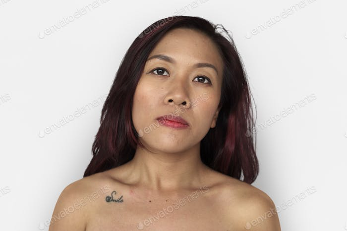 Asian woman bare chest topless studio portrait