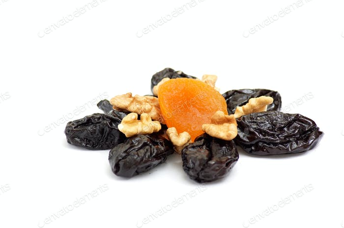 Dried apricot,walnuts and prunes on a white.