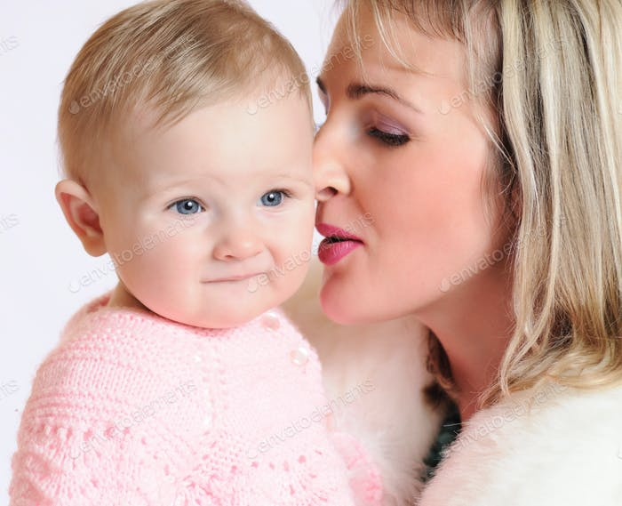 Close-up of a woman snuggling nose to a child