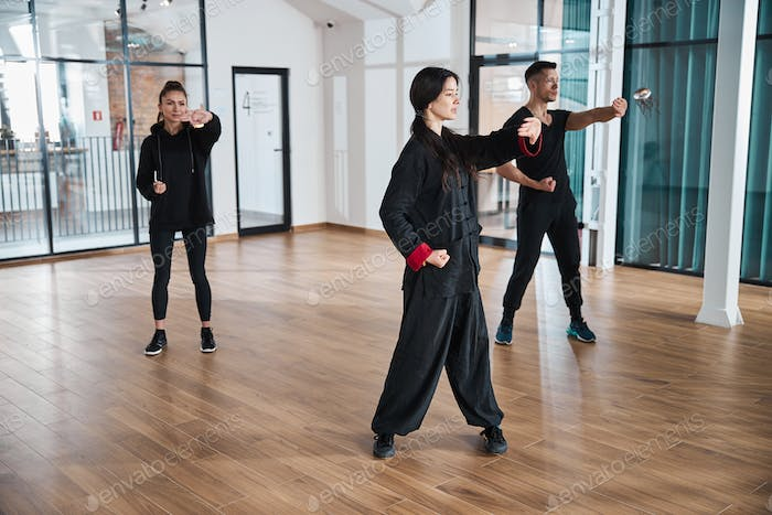 Qigong activity in a room with glass walls
