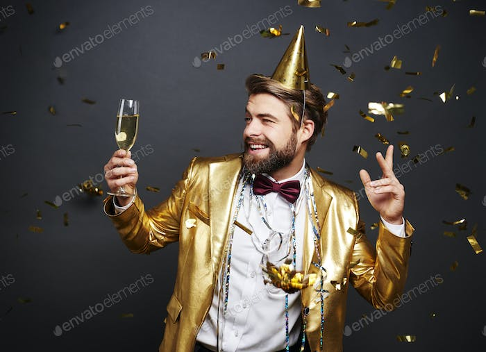 Man with champagne flute greeting new year's day
