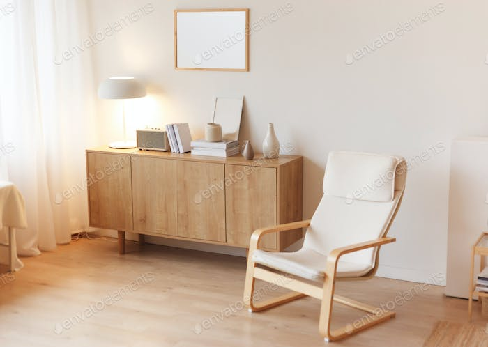 Modern minimalistic interior with chest of drawers an braided armchair. Scandinavian style.